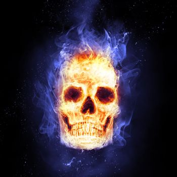 Burning skull in flames in the darkness