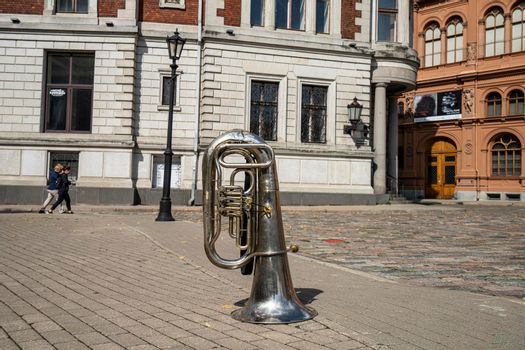 a trombone on the sidewalk