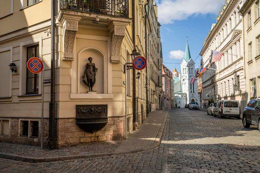 a small statue in Riga, Latvia