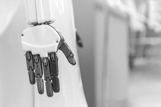 black and white photo of the hand of humanoid robot