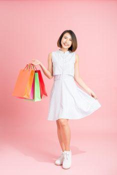woman in sundress shopping shopaholic