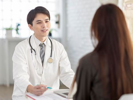 Young doctor talking to patient.