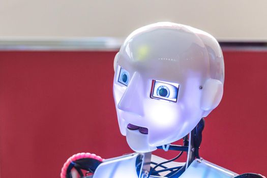 Head with the lightning eyes of humanoid robot