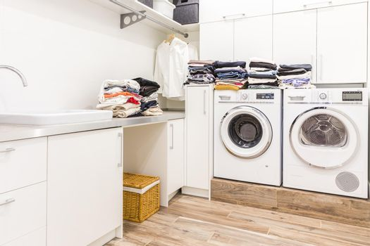 Stacks of clean clothes in utility room