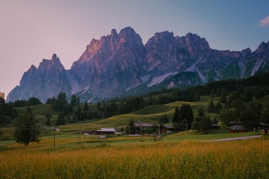 Cortina d'Ampezzo town panoramic view with alpine green landscape and massive Dolomites Alps in the background. Province of Belluno, South Tyrol, Italy.
