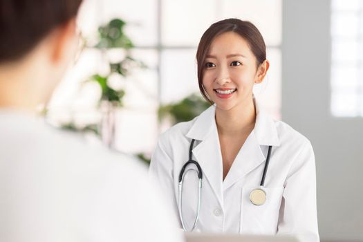 Doctor talking with patient in clinic.