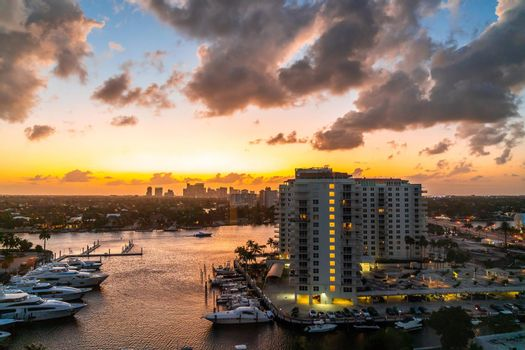 Aerial view of Fort Lauderdale waterway canals, residential homes and skyline at sunset