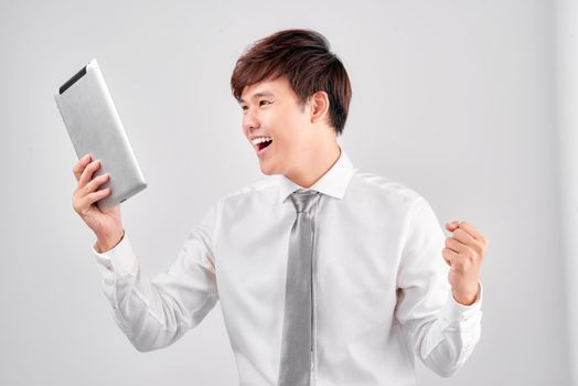 astonished man shopper consumer surprised excited by online win isolated on white