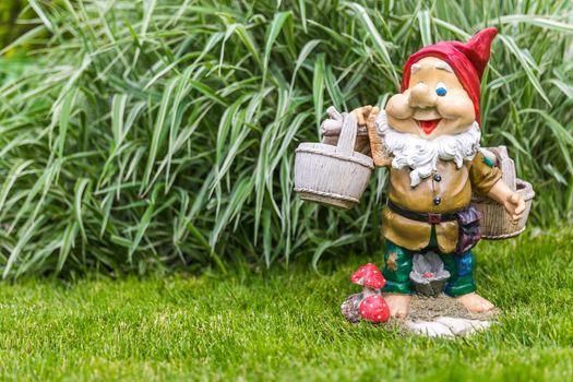 garden dwarf in home garden, nice gnome decoration