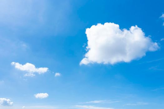 One  fluffy white cloud in  blue sky