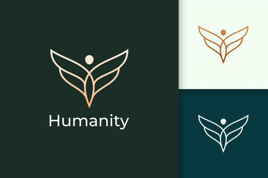Luxury freedom logo in human and wing represent humanity or peace