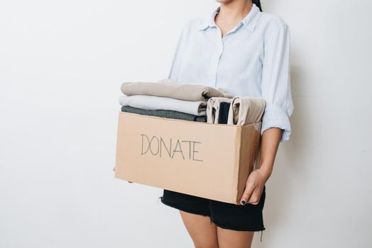 clothes in box for concept donation and reuse recycle