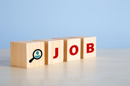The word job on wooden cubes with on blue background.