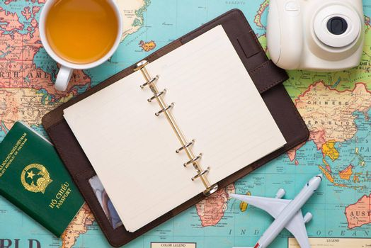 Travel. Trip. Vacation - Top view of airplane, camera, passport and touristic map