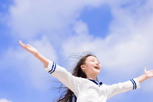 Excited and Happy student girl with her hands up