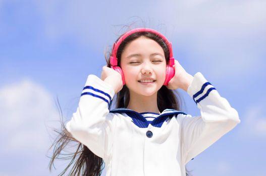 happy student girl enjoy listen music with headphone