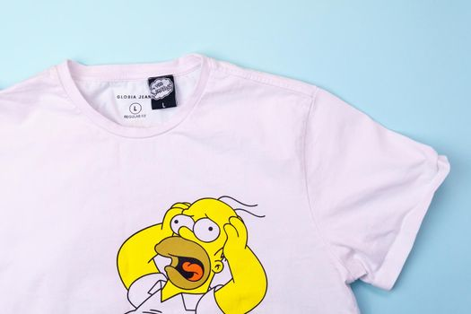 Tyumen, Russia-August 27, 2021: Simpsons on a Homer Simpson T-shirt. American adult animated sitcom created by Matt Groening