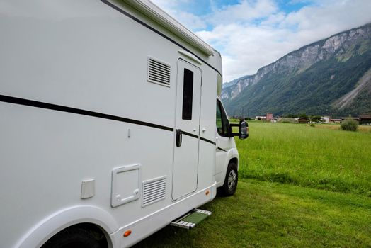 Caravan car vacation. Family vacation travel RV. Holiday trip in motorhome. Switzerland natural landscape