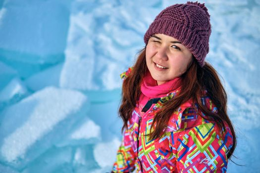 A woman with long hair in winter ski clothes, winter weekend activities