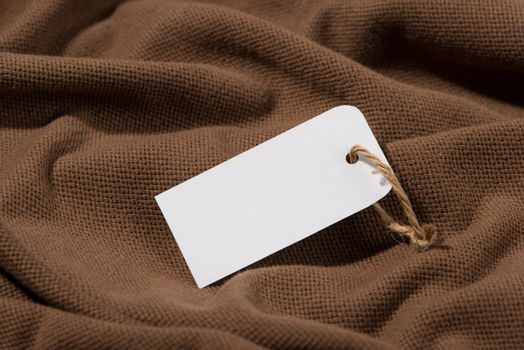 Shirt price tag. Rectangular tag is attached to a sweater