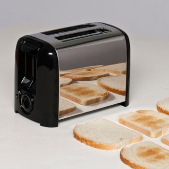 Conceptual image of toaster with bread