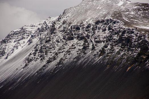 Snow capped mountain ridge black and white Icelandic texture heavenly awe inspiring wow breathtaking