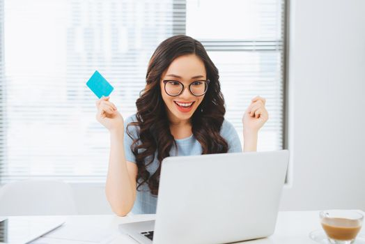 Young asian businesswoman using credit card for on-line payment