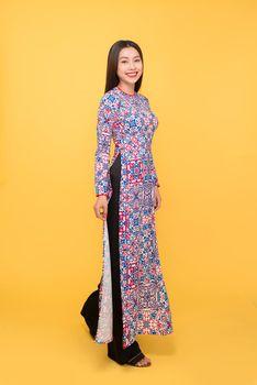 Full-length portrait of Vietnamese girl in ao-dai dress