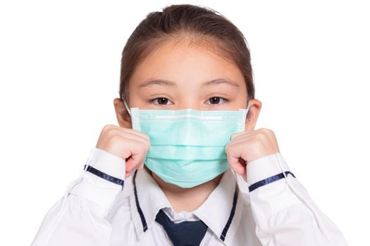 Girl in a medical mask.Isolated on white background.