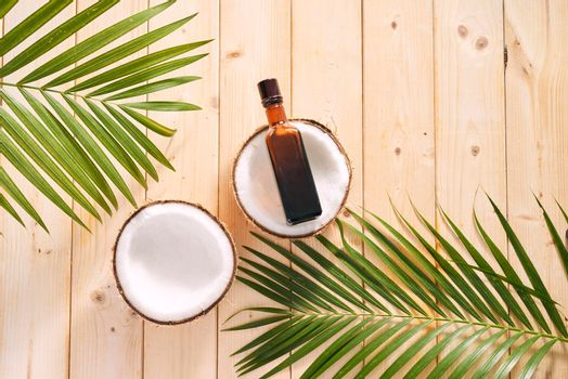 coconuts and coconut oil on wooden background.