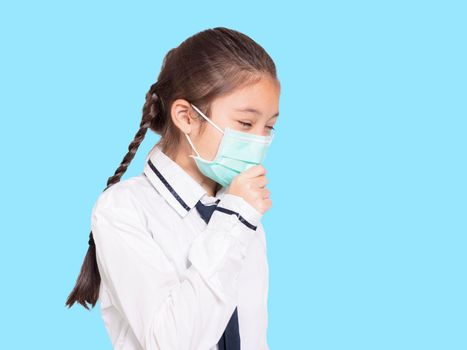 Girl in a medical mask coughing.Isolated on blue background.