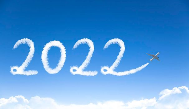 happy New year 2022 concept. cloud drawing by airplane in sky