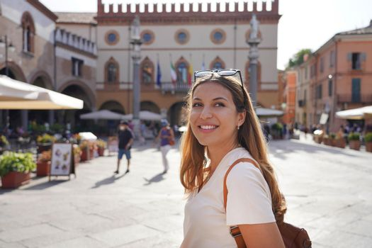 Portrait of beautiful stylish woman doing cultural visit of medieval old town, Ravenna, Italy