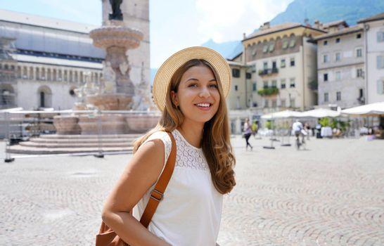 Cultural tourism in Italy. Traveler girl in the city of Trento, Italy.