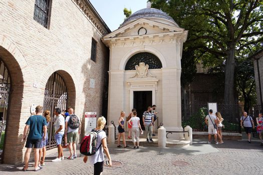 RAVENNA, ITALY - AUGUST 10, 2021: people visiting the tomb of Dante Alighieri Italian poet in Ravenna on the occasion of the 700th anniversary of his death