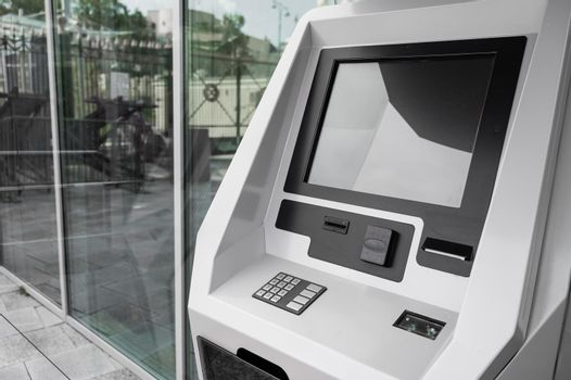 Close-up of a ticket vending machine with a blank black screen
