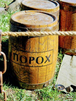 old large barrels on the road of gunpowder