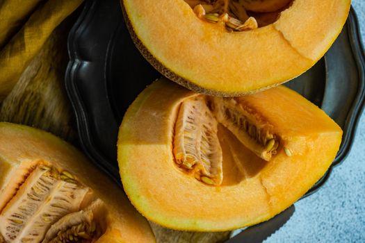 Slices of ripe melon in bowl