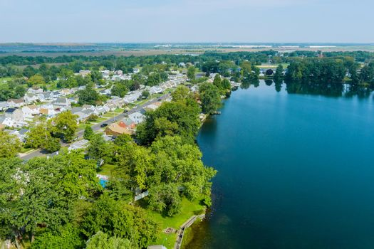 Aerial view of American town a homes on residential district Sayreville near pond in New Jersey US
