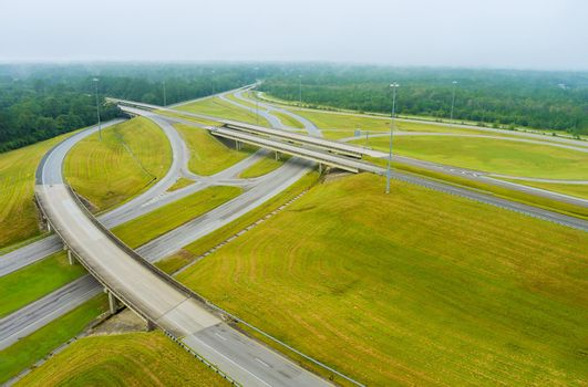 Misty morning over a desolate country road with bridge across US 65 Highway near Satsuma, Alabama