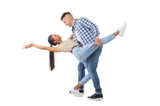 Young couple dancing on white
