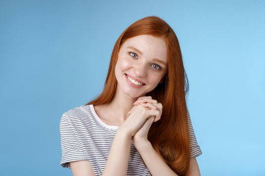 Romantic tender lovely redhead girlfriend tilting head press palms together smiling touched look sympathy check out cute picture friend standing delighted amused, heartwarming moment