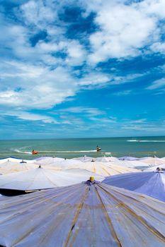 Large umbrella crowded along Cha-Am beach