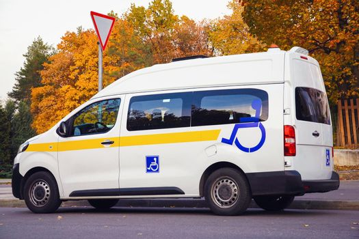 Minibus for disabled passengers with disability signs