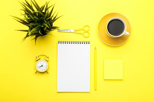 Office stationary flat lay on yellow trendy background