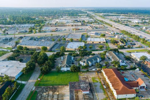 Aerial overlooking Houston city of beautiful highway Texas with traffic line in 45 Interstate expressway around mall plaza USA