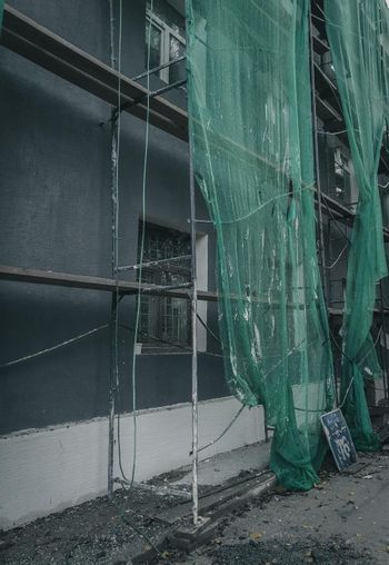 Reconstruction of the facade of a residential building. Construction works in the city. Grain and noise.