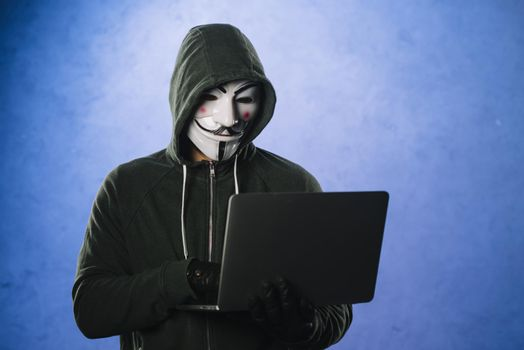 hacker with anonymous mask. High quality beautiful photo concept