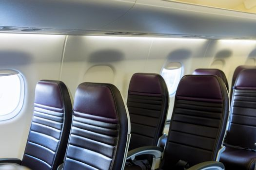 Left armchairs in a built-in chairs Aircraft Cabin Economy class