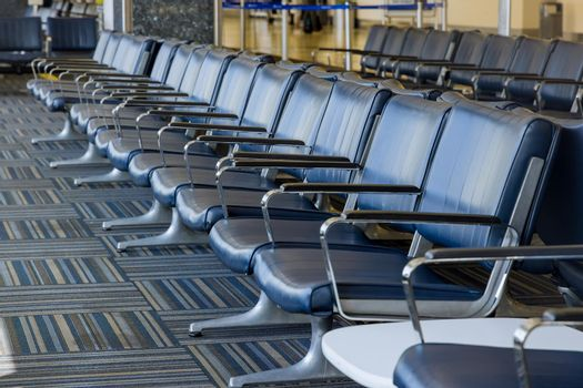 Empty airport departure lounge terminal waiting area with chairs